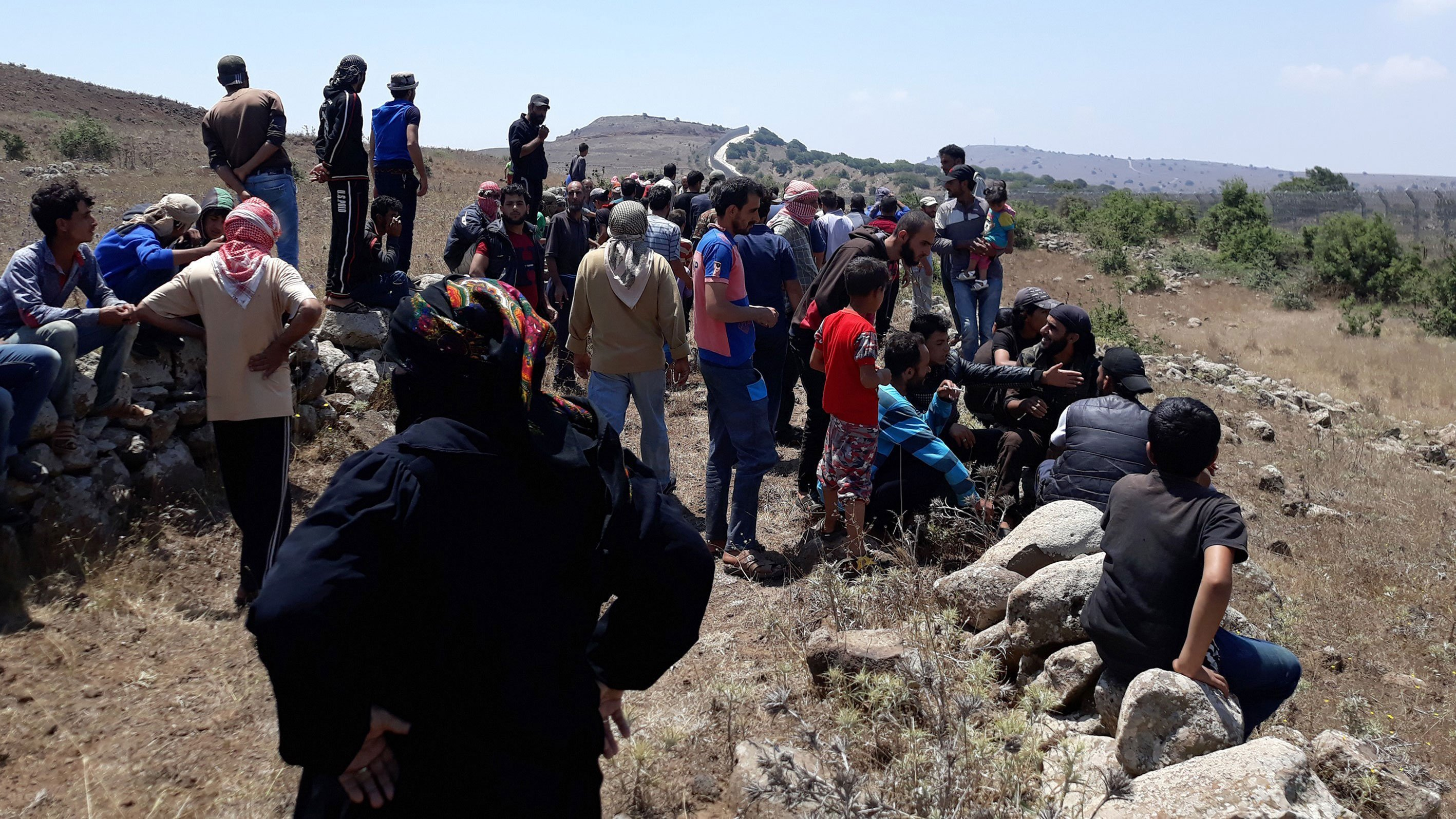 Displaced Syrians march close to Israel; airstrike kills 10