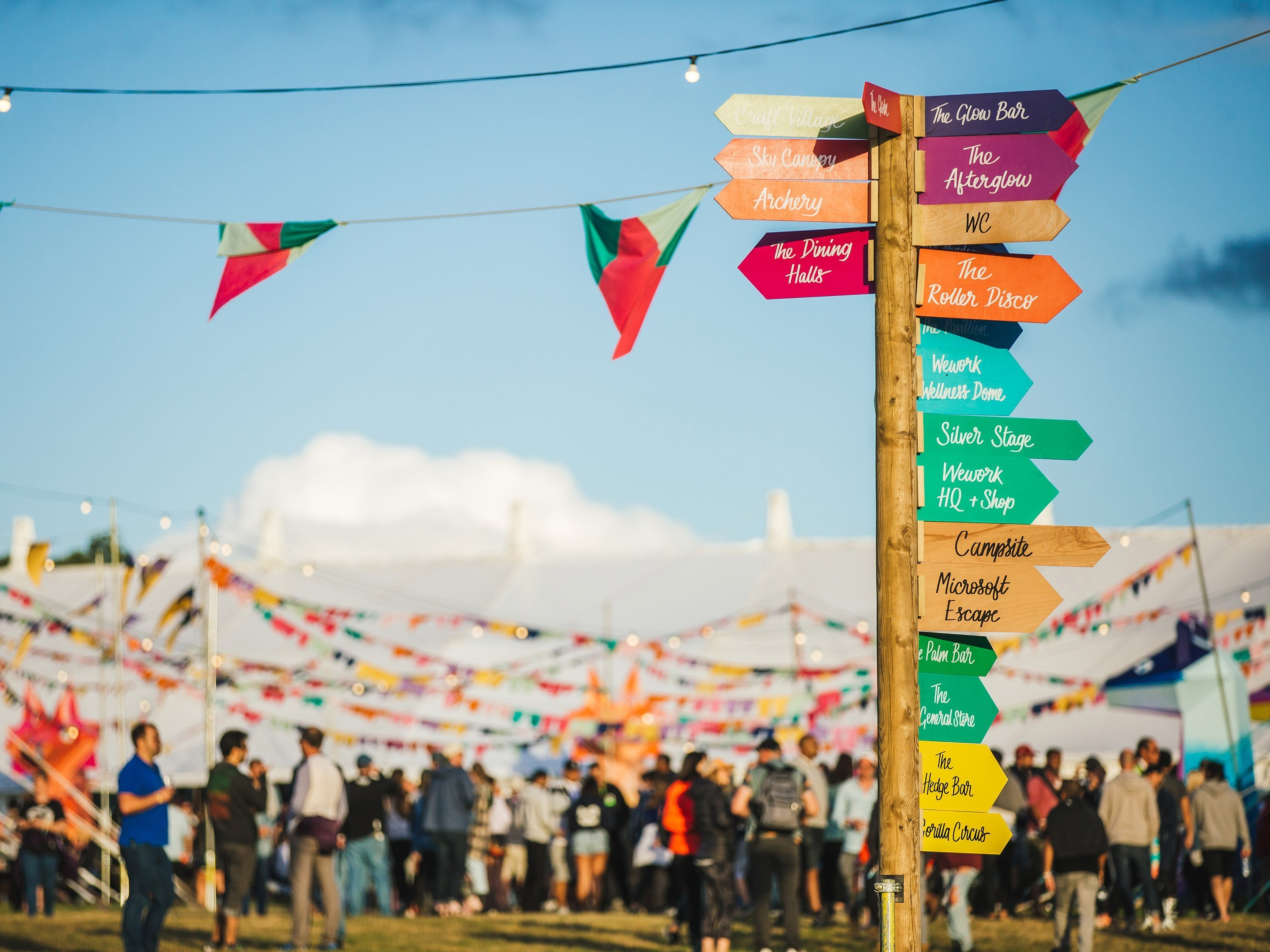 Some 8,000 WeWork employees from around the world descend on a bucolic pasture in England for the company's seventh annual summer camp.