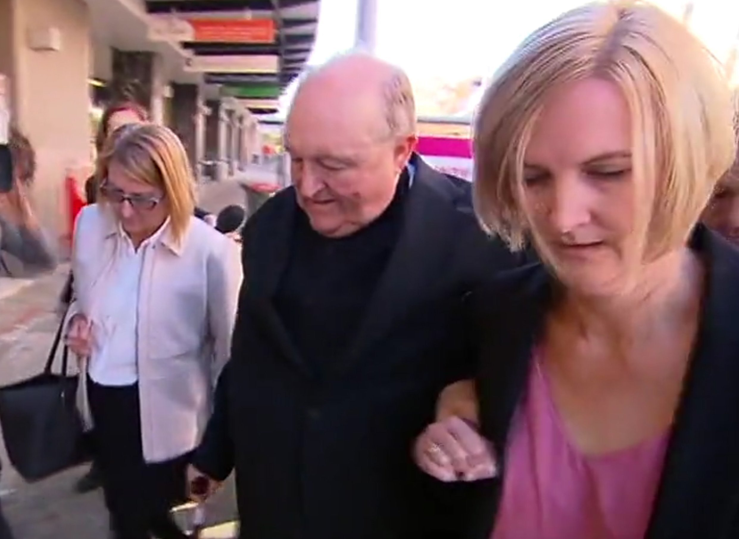 Australian Archbishop Philip Wilson (middle) is the highest ranking Catholic official to be convicted of covering up sexual abuse.