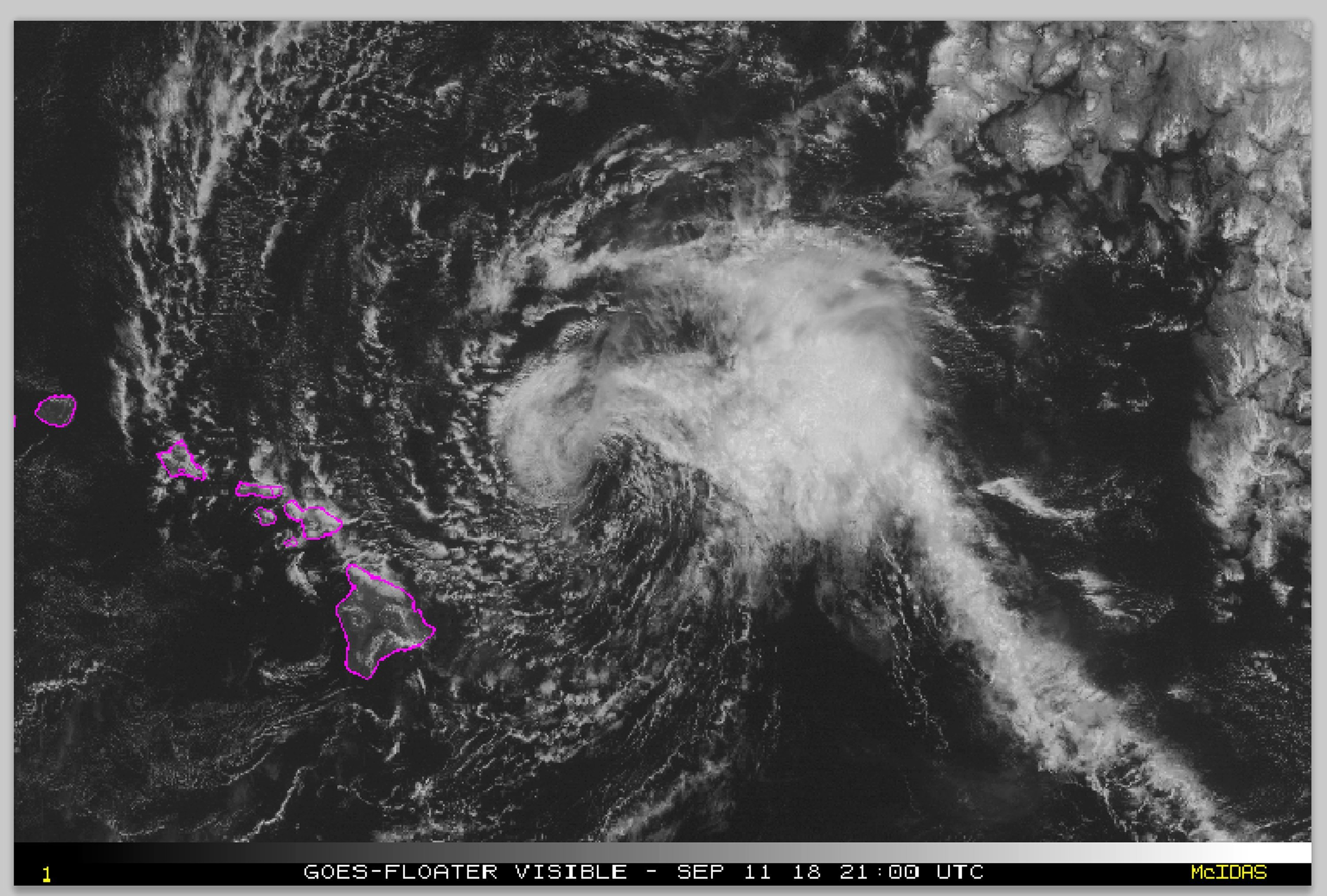 A satellite image shows Tropical Storm Olivia as it moves east of Hawaii's main islands Tuesday.