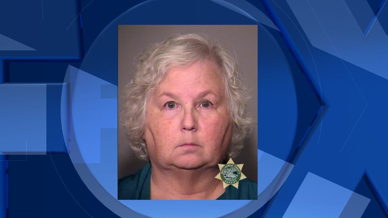 **Embargo: Portland, Ore.**  Nancy Crampton Brophy was taken into custody at her Beaverton home Wednesday night in connection to her husband's death.