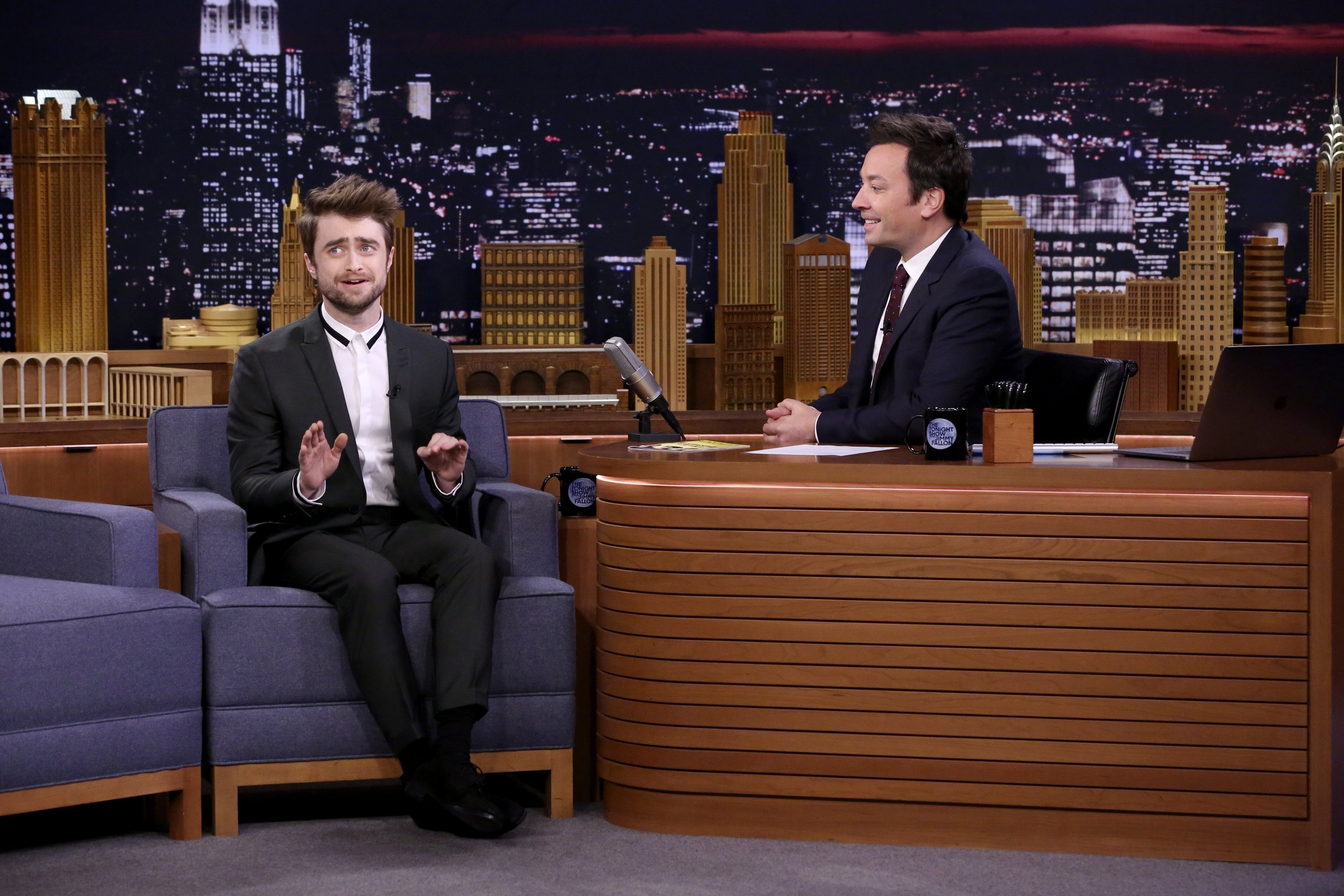 "Actor Daniel Radcliffe talks with Jimmy Fallon on September 12, 2018, on ""The Tonight Show"" set."