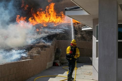 Nearly 70,000 people under mandatory evacuation orders as two new wildfires in Southern California spread rapidly - WRCBtv.com